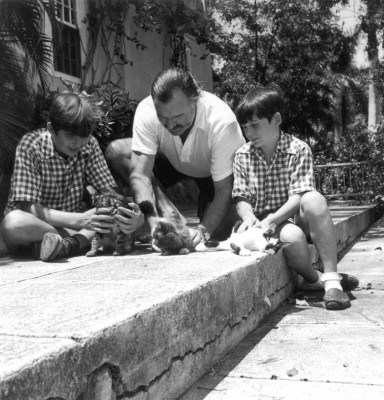 American Author Ernest Hemingway with sons Patrick (left) and Gregory (right) with kittens in Finca Vigia, Cuba